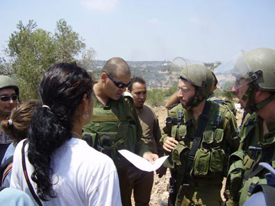 ISM volunteers negotiatiate a five-minute ceasefire with soldiers to allow Palestinians time to leave before they continue to shoot.