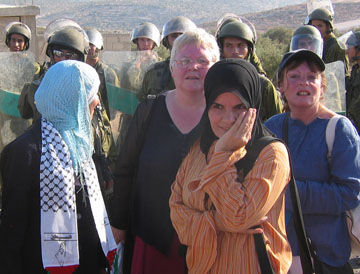 Two women from Belfast join Bil'in women in the West Bank during a demonstration against the occupation.