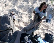 Seven year old Huda Ghalia weeping on Beit Lahia beach after an Israeli shell wiped out nearly her entire family