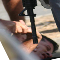 Police torturing Mohammed Mansour during his arrest in Ar-Ram June 2004