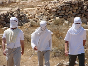 Israeli Colonist Wear:  Tallis, Tzitzis, and Mask