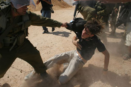 An ISM demonstrator gets dragged by soldiers